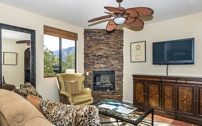 Living room with stacked stone fire place
